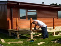Man building a Lodge